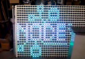 A pixel-art version of the Baltimore Node logo rendered on a wall of LED's, an array of RGB Christmas lights.